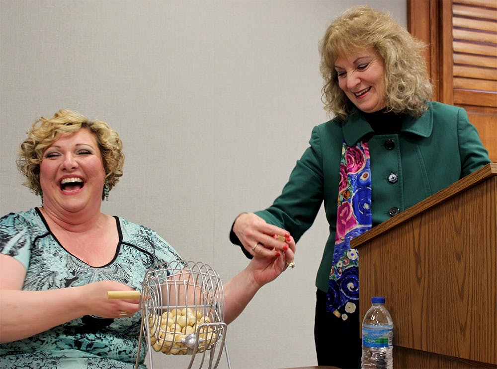State Superintendent of Public Instruction Glenda Ritz leads a Bingo for Books event with Teresa Heidenreich, library director at Washington Carnegie Pulbic Library. The event was in celebration of National Library Week. Before the Bingo began, Ritz spoke to those gathered about the importance of literacy.