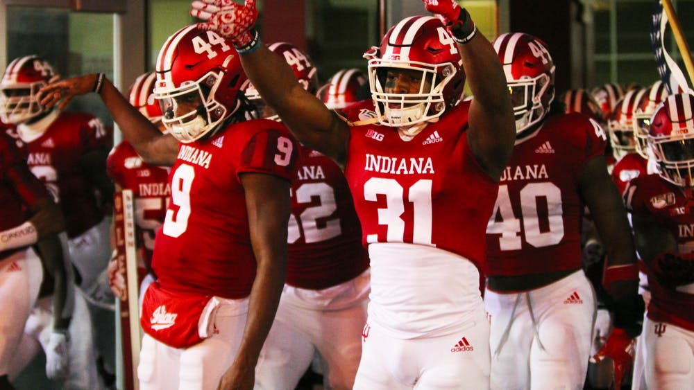 Sophomore defensive back Bryant Fitzgerald cheers as he arrives on the field Nov. 2 at Memorial Stadium before IU played Northwestern.
