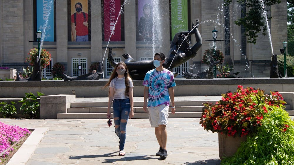 Then-freshmen Carter Tran and Allison walking Aug. 24, 2020 near Showalter Fountain. The Monroe County Board of Commissioners voted Wednesday to approve a new health order requiring masks to be worn in indoor public places regardless of vaccination status, effective 8 a.m. Thursday.