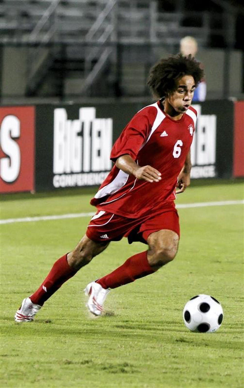 Junior back/midfielder Kevin Alston dribbles the ball during the Hoosiers 3-1 win against No. 9 Notre Dame on Oct. 16 at Bill Armstrong Stadium. IU soccer coach Mike Freitag confirmed Monday that Alston will turn pro passing up his senior season with the Hoosiers.