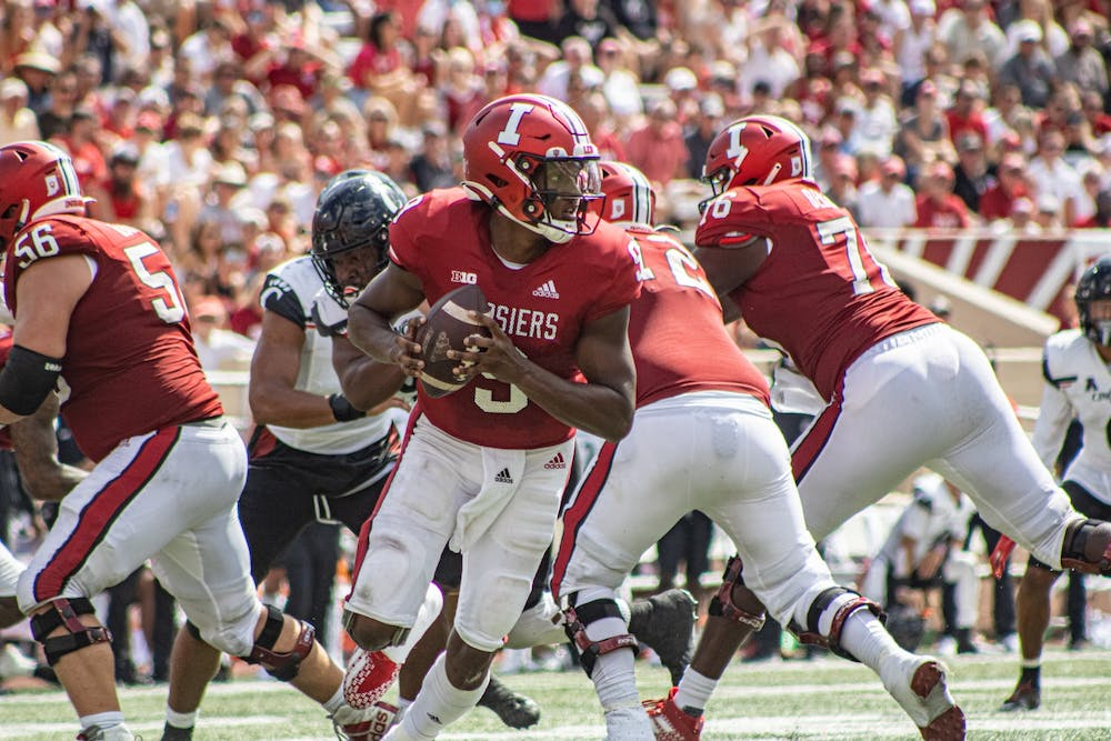 <p>Junior quarterback Michael Penix Jr. rolls out during a play against the University of Cincinnati on Sept. 18, 2021, at Memorial Stadium. Penix reached his 2020 interception total by the second quarter against the University of Cincinnati, then surpassed it by two interceptions later in the game.</p><p><br/><br/></p>