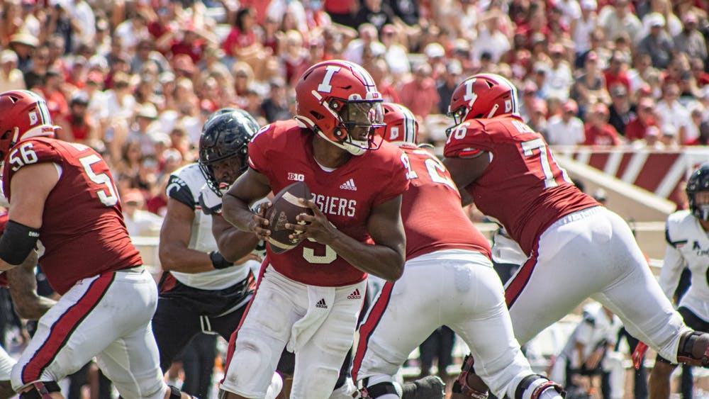 Junior quarterback Michael Penix Jr. rolls out during a play against the University of Cincinnati on Sept. 18, 2021, at Memorial Stadium. Penix reached his 2020 interception total by the second quarter against the University of Cincinnati, then surpassed it by two interceptions later in the game.