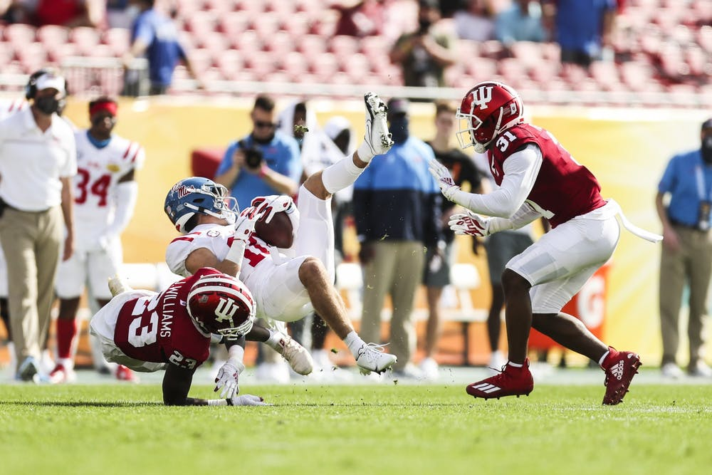 <p>Junior defensive back Jaylin Williams and redshirt junior defensive back Bryant Fitzgerald tackle an opponent Jan. 2 at Raymond James Stadium in Tampa, Florida. The Hoosiers lost to Ole Miss 20-26 in the Outback Bowl. </p>