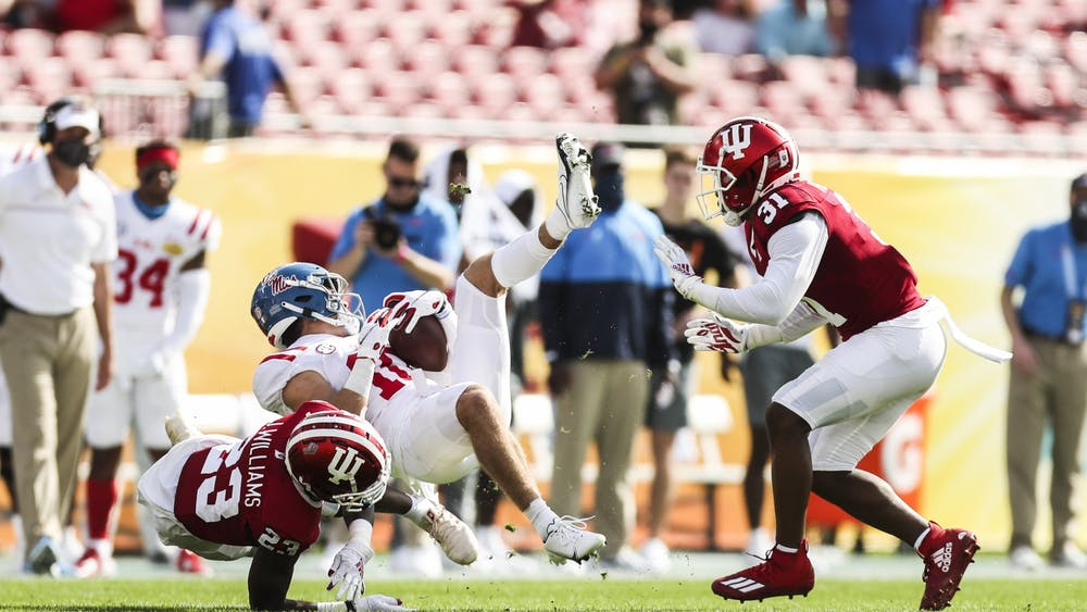 Junior defensive back Jaylin Williams and redshirt junior defensive back Bryant Fitzgerald tackle an opponent Jan. 2 at Raymond James Stadium in Tampa, Florida. The Hoosiers lost to Ole Miss 20-26 in the Outback Bowl.