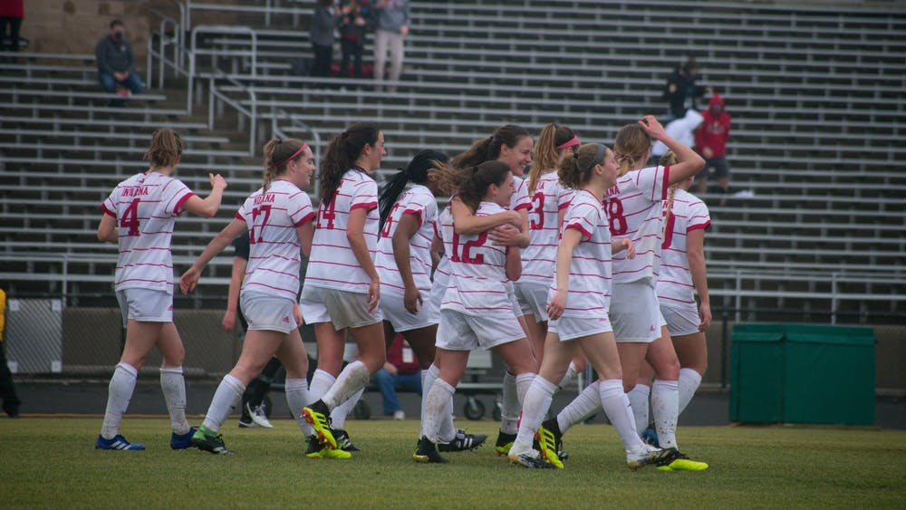 The IU women's soccer team walks across the pitch at Bill Armstrong Stadium during a game against Iowa on Feb. 28. IU fell 1-0 to Illinois on Saturday at Bill Armstrong stadium.