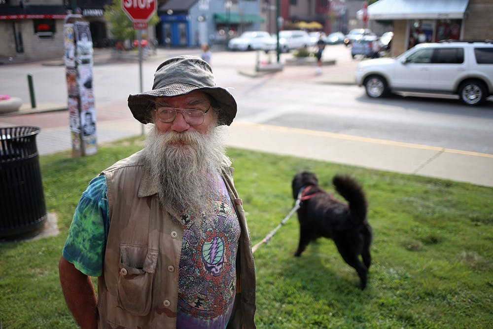 """Rod Gesner, Bloomington, is known around downtown for parking his RV on Kirkwood to practice his ministry and share his wares - wooden rods that he makes. He calls his dog, Kiaayo, a """"comfort/therapy wonder dog."""" Gesner serves as one of the few links between the homeless population on the north side of Kirkwood and the rich college kids at the bars on the south side."""