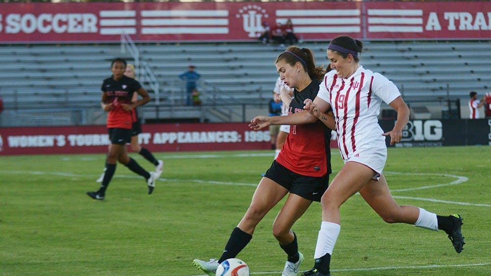 Junior forward Lauren Joray works thorugh the Ball State University Cardinals' defense at Bill Armstrong stadium on Sunday evening. The game ended in a 1-1 draw.