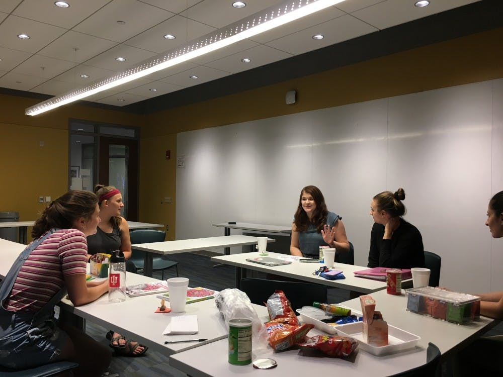 Raising Awareness of Interactions in Sexual Encounters group members relax with tea and snacks and discuss the recent Kavanaugh events. The group is a sexual assault education group that does not have University oversight.