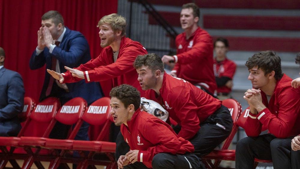 Members of the IU wrestling team cheer on their teammates Nov. 22, 2019, at Wilkinson Hall. Graduate transfer Garrett Hoffman will join an IU heavyweight group that struggled last year.