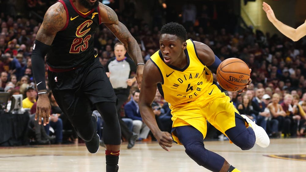 The Indiana Pacers' Victor Oladipo, right, drives against the Cleveland Cavaliers' LeBron James in Game 5 of a first-round playoff series April 25, 2018, at Quicken Loans Arena in Cleveland. Oladipo had to have surgery after rupturing a tendon in his right quad in January 2019 and wasn't able to return to play until late January 2020.
