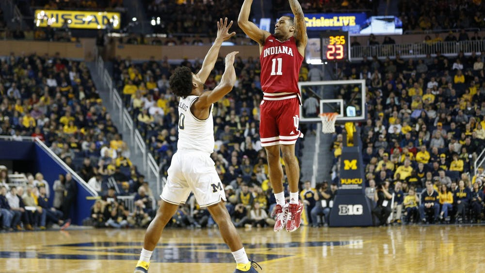 Then-senior guard Devonte Green pulls up for a 3-pointer against Michigan then-sophomore guard David DeJulius on Feb. 16, 2020, in Ann Arbor, Michigan. This year's Maui invitational will now be played in Asheville, North Carolina.