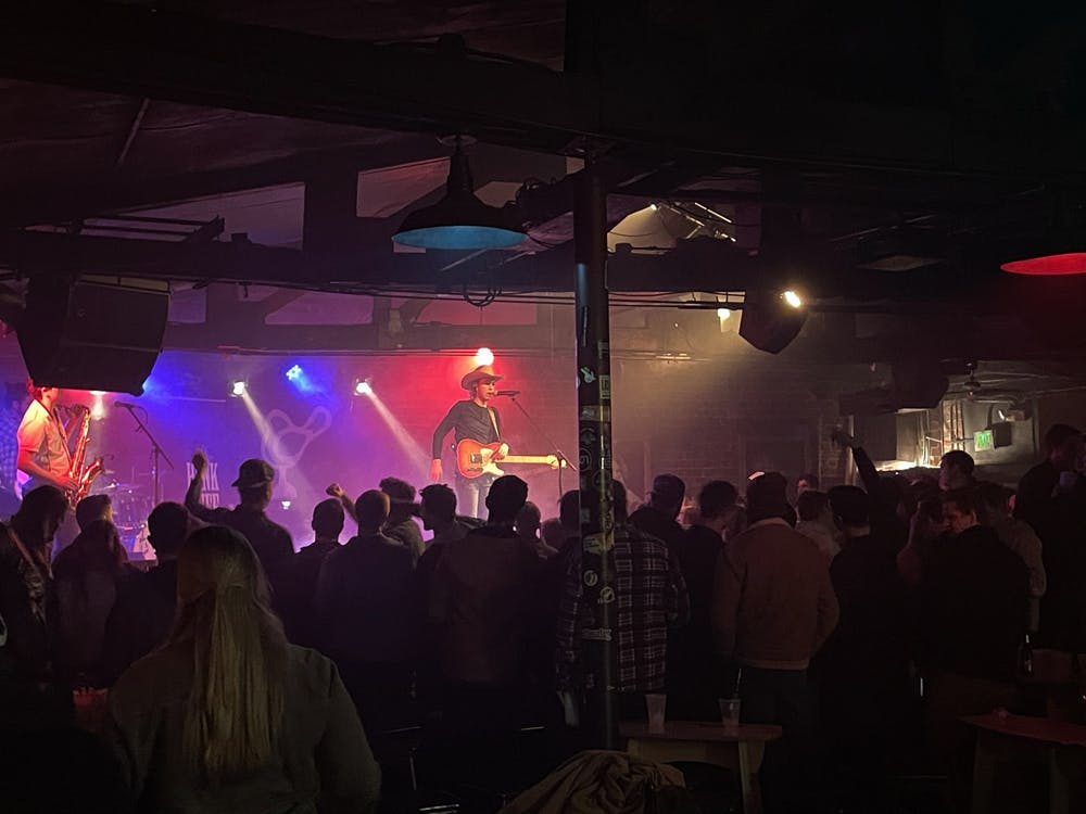 Local country artist Hank Ruff performs for a sold-out crowd at the Bluebird Feb. 13. Ruff frequently reached down to touch the hands of people in the audience and at one point invited someone from the crowd onstage for a shotgun race.