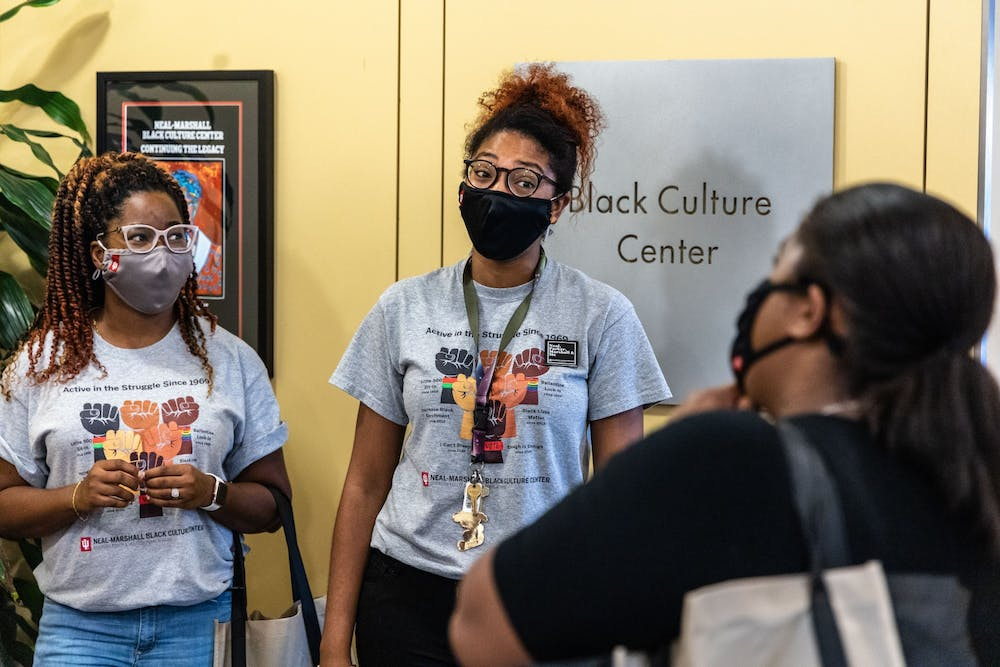<p>Graduate assistants Dionne White and Brandi Loving greet a student Aug. 23, 2021, during the Neal-Marshall Black Culture Center open house. The event was the center&#x27;s first in-person activity in more than a year. </p>