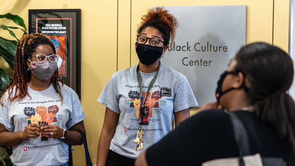 Graduate assistants Dionne White and Brandi Loving greet a student Aug. 23, 2021, during the Neal-Marshall Black Culture Center open house. The event was the center's first in-person activity in more than a year.