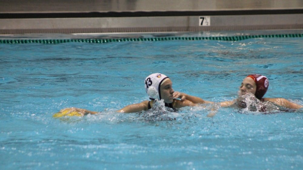 Jessica Castellano of California Baptist University defends the ball from IU junior Jennifer Beadle at Councilman-Billingsley Aquatics Center in February of 2017. IU will be heading to the Bay Area this weekend as the Hoosiers get set to play in the Santa Clara Invitational.