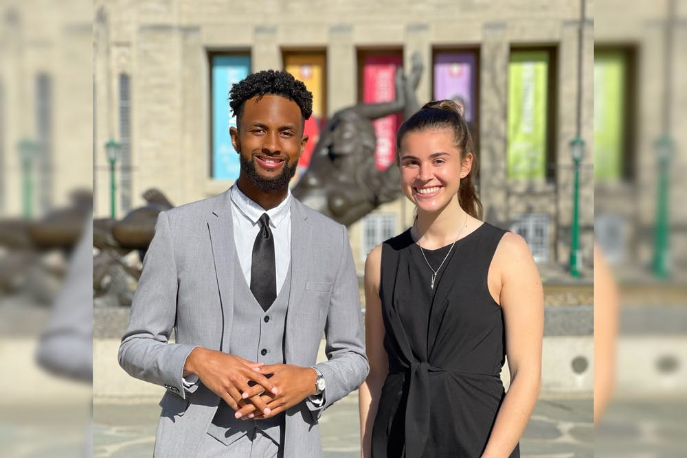 <p>IU Student Government President-elect Ky Freeman, left, and Vice President-elect Madeline Dederichs, right, pose for a photo near Showalter Fountain. The IUSG Supreme Court certified Elevate as the winners of the presidential election Wednesday. </p>