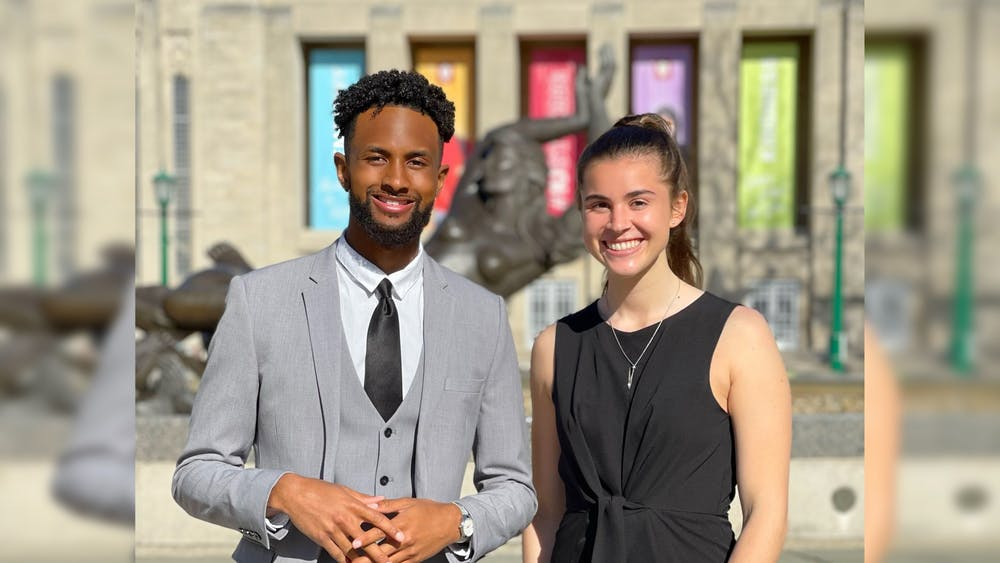 IU Student Government President-elect Ky Freeman, left, and Vice President-elect Madeline Dederichs, right, pose for a photo near Showalter Fountain. The IUSG Supreme Court certified Elevate as the winners of the presidential election Wednesday.