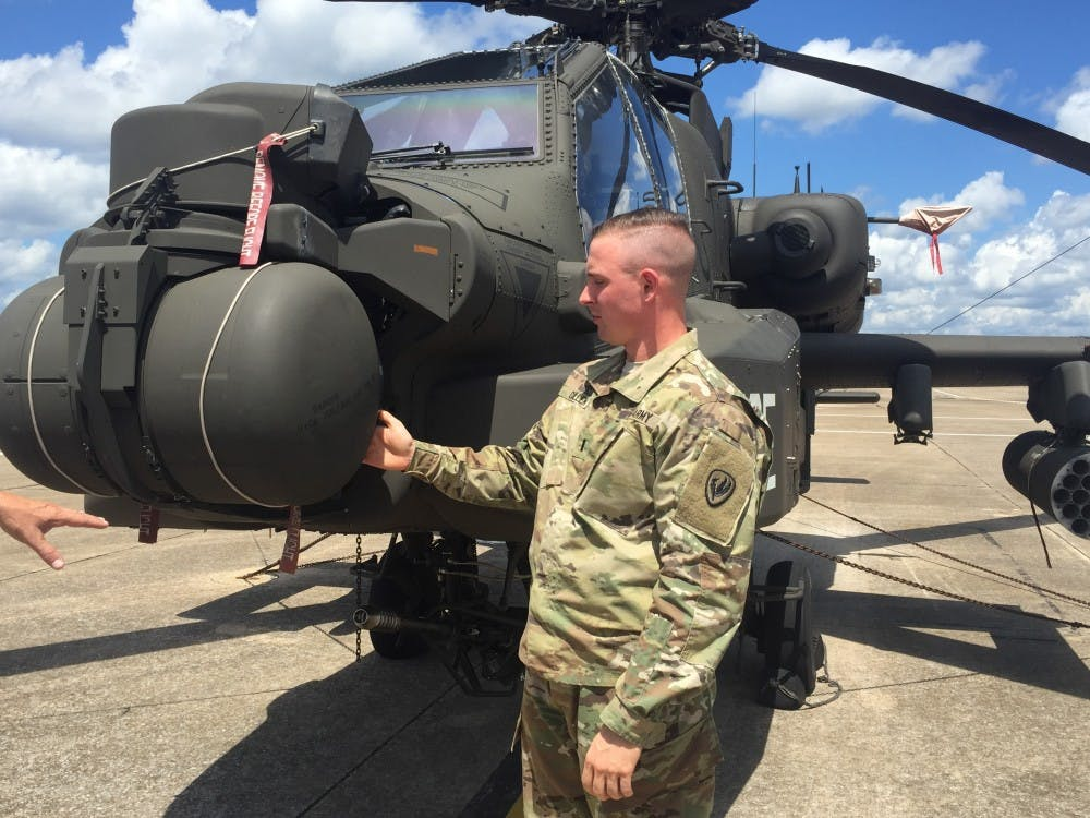 <p>1st Lt. Clayton Cullen stands next to his AH64 Apache helicopter at Fort Rucker, Alabama Aug. 16, 2017. Cullen died in a helicopter crash during training operations at the National Training Center at Fort Irwin, California.</p>