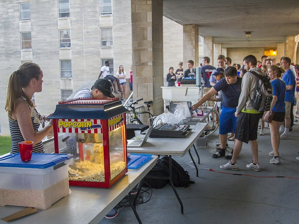 Students line up for popcorn and cotton candy Monday evening on the Teter Quad during a carnival put on by the Teter RA's.