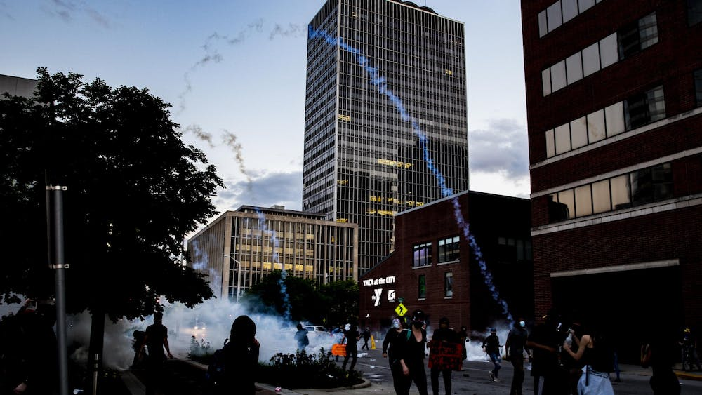 Tear gas streams fly in the air during a protest May 30 in downtown Indianapolis.