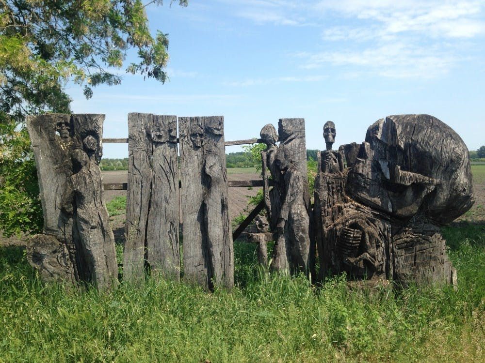 "Art installations line the road on the way to the Bridge at Andau in northern Hungary. Travel Columnist Lauren Fazekas biked to the bridge after reading ""The Bridge at Andau"" by journalist and author James A. Michener."