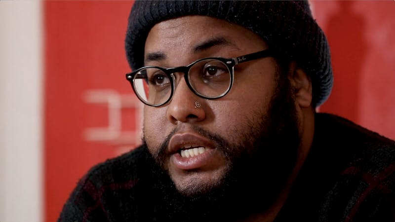 Terin J.D., owner of Cry Babies Electric Tattooing, discusses the importance of imperfections in tattoos Jan. 18 at his studio. J.D.'s unconventional tattooing process includes drawing the tattoos on the skin with a ballpoint pen, as opposed to using a stencil.