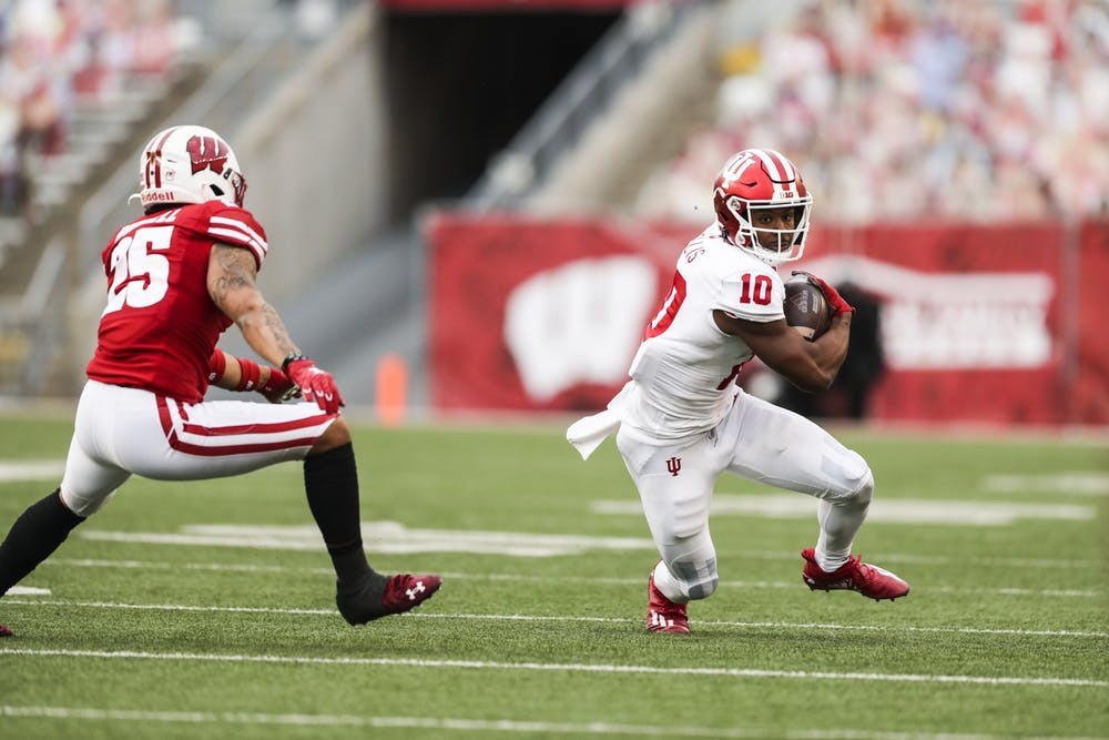 <p>Junior wide receiver David Ellis runs with the ball during the game Dec. 5 at Camp Randall Stadium in Madison, Wisconsin.</p>