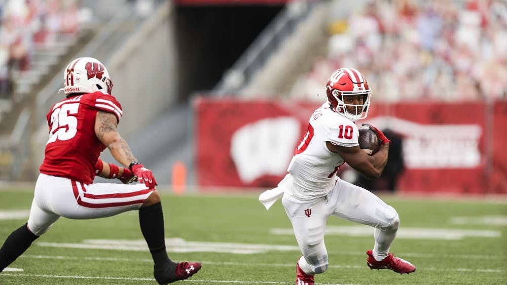 Junior wide receiver David Ellis runs with the ball during the game Dec. 5 at Camp Randall Stadium in Madison, Wisconsin.