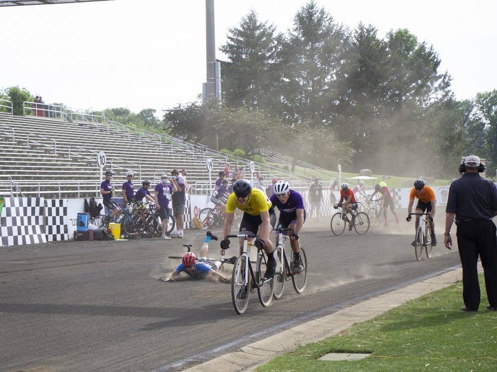 Sophomore Ben Baines falls during the men's Little 500 on Wednesday at Bill Armstrong Stadium.