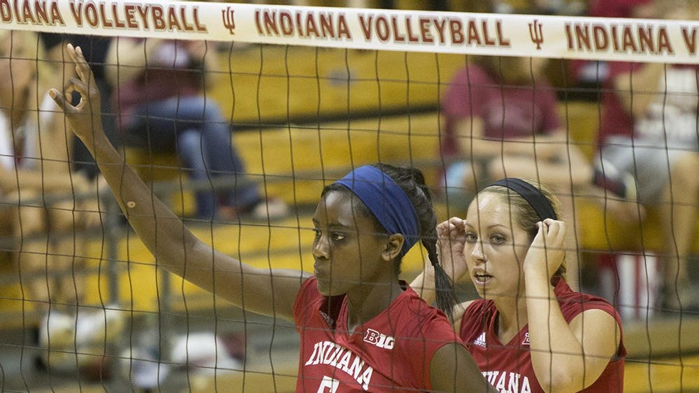 Sophomore Jazzmine McDonald, front, and sophomore Allison Hammond, back, set up a play during the Hoosier's game vs. SEMO Saturday at Assembly Hall.