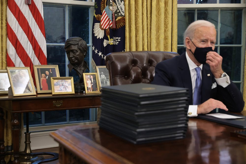 <p>President Joe Biden prepares to sign a series of executive orders at the Oval Office hours after his inauguration on Jan. 20, in Washington. Biden has signed orders to address advancing racial equity and support for underserved communities and economic relief for COVID-19.</p>