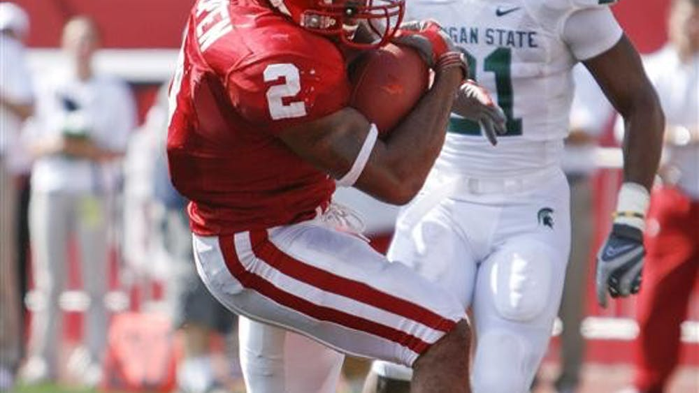 Senior running back Marcus Thigpen scores one of his three touchdowns during the Hoosiers' 42-29 loss to Michigan State Saturday afternoon at Memorial Stadium. Thigpen finished with 207 total yards.