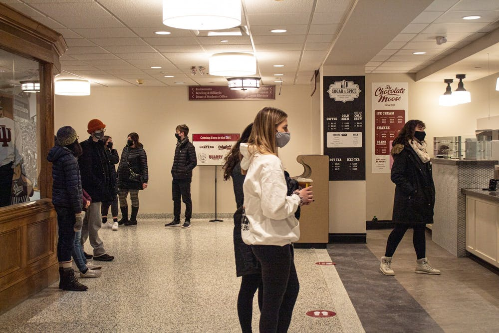 <p>Students wait for their orders Tuesday at Sugar and Spice in the Indiana Memorial Union. Students have been a  factor for COVID-19 spread in college towns.</p>