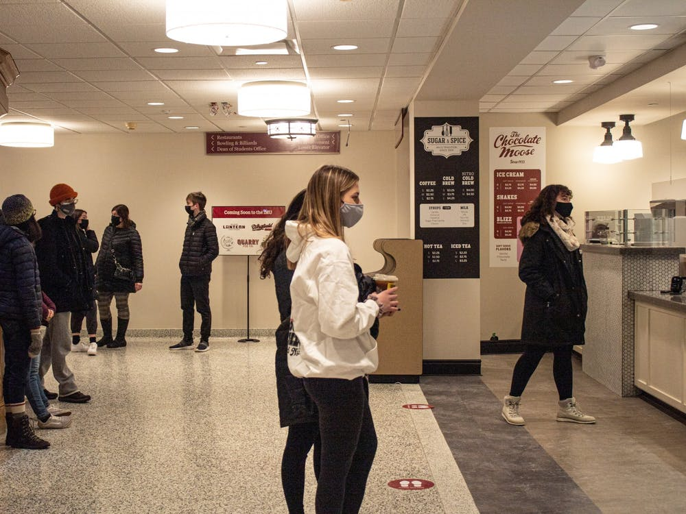 Students wait for their orders Tuesday at Sugar and Spice in the Indiana Memorial Union. Students have been a  factor for COVID-19 spread in college towns.