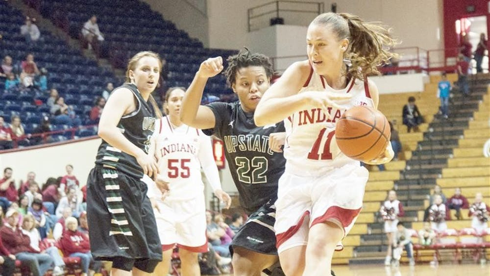 Senior Andrea Newbauer drives to the basket during the game against USC Upstate on Sunday at Assembly Hall.