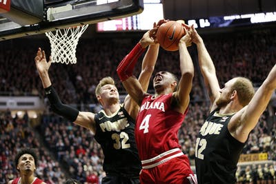 Freshman forward Trayce Jackson-Davis goes up for a dunk against Purdue junior center Matt Haarms and senior forward Evan Boudreaux. The Hoosiers trailed the Purdue Boilermakers 29-20 at halftime in West Lafayette, Indiana.