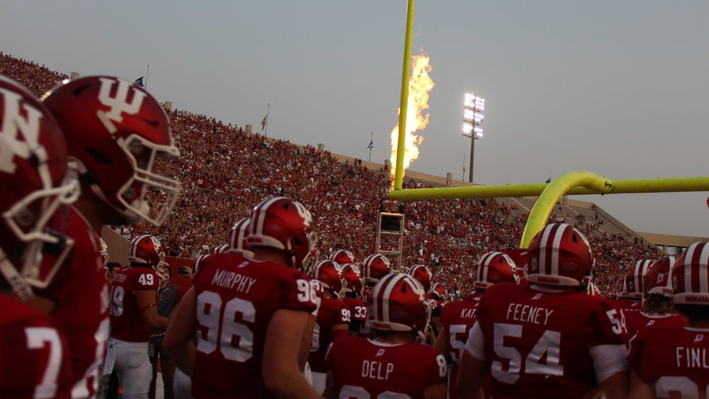 """The Indiana football team exits the locker room Sept. 11, 2021, ahead of its game against the University of Idaho. This Saturday's game against No. 4 Penn State will be the first time Indiana will play on ABC's """"Saturday Night Football""""."""