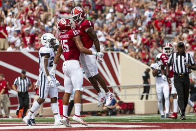Junior wide receiver Whop Philyor, right, celebrates in the end zone with fifth-year wide receiver Nick Westbrook, left, after scoring IU's first touchdown of the game Sept. 21 at Memorial Stadium against University of Connecticut.