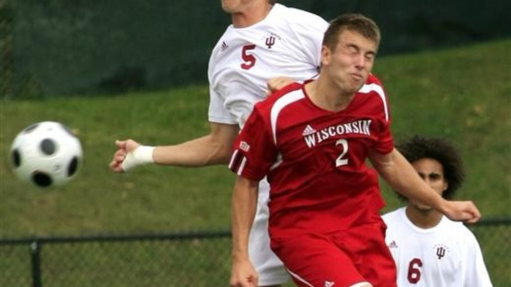 IU midfielder Brad Ring battles with Wisconsin's Brandon Miller during a game on Sept. 21 at Bill Armstrong Stadium.