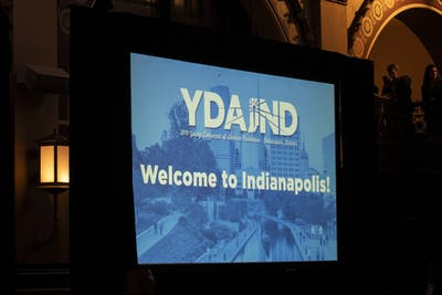"""A screen reads, """"Welcome to Indianapolis,"""" on July 19 at the Crowne Plaza in Indianapolis. House Speaker Nancy Pelosi spoke at the 2019 Young Democrats of America National Convention."""