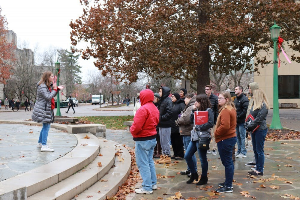 <p>IU student orientation leaders give campus tours to high school students in front of the Fine Arts Building November 2018. Campus tours are now being done virtually. </p>