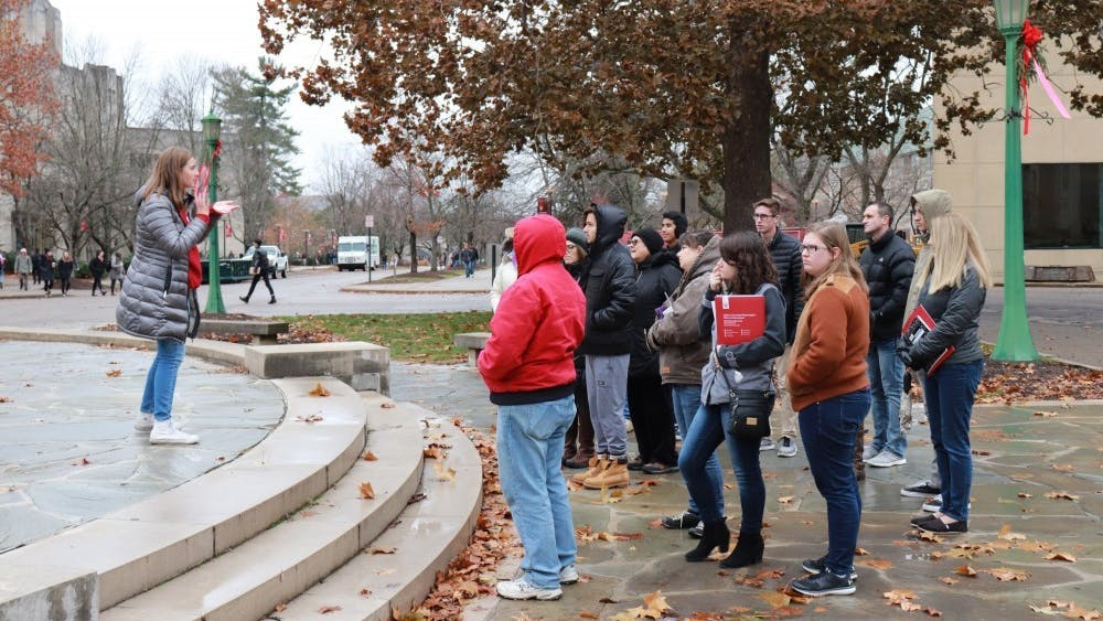 IU student orientation leaders give campus tours to high school students in front of the Fine Arts Building November 2018. Campus tours are now being done virtually.