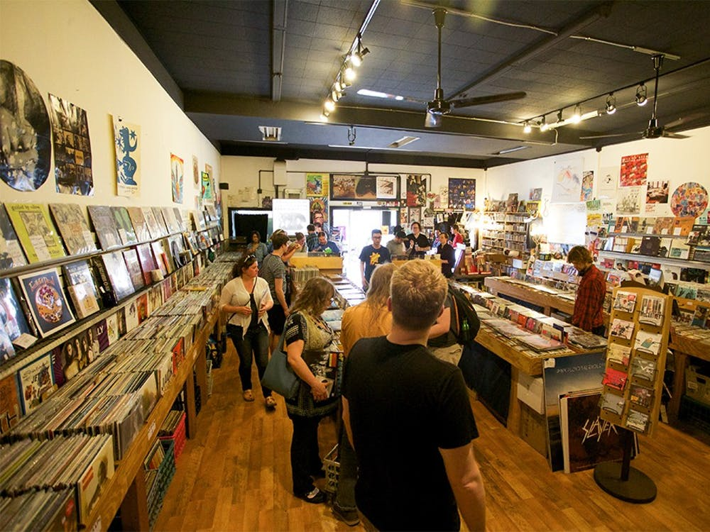 Customer pick out records on Record Store Day at Landlocked Music on April 18, 2015.