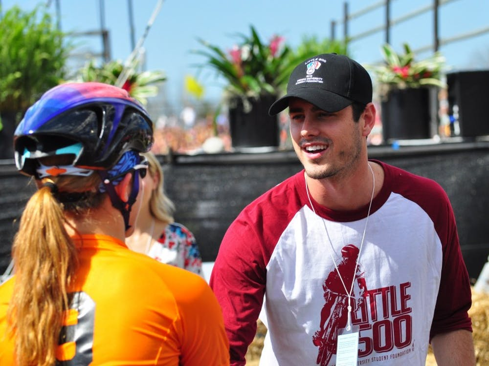 """Ben Higgins, IU alumnus and former star of the television show """"The Bachelor"""" wishes good luck to a team shortly before the start of the 2016 Women's Little 500 race."""