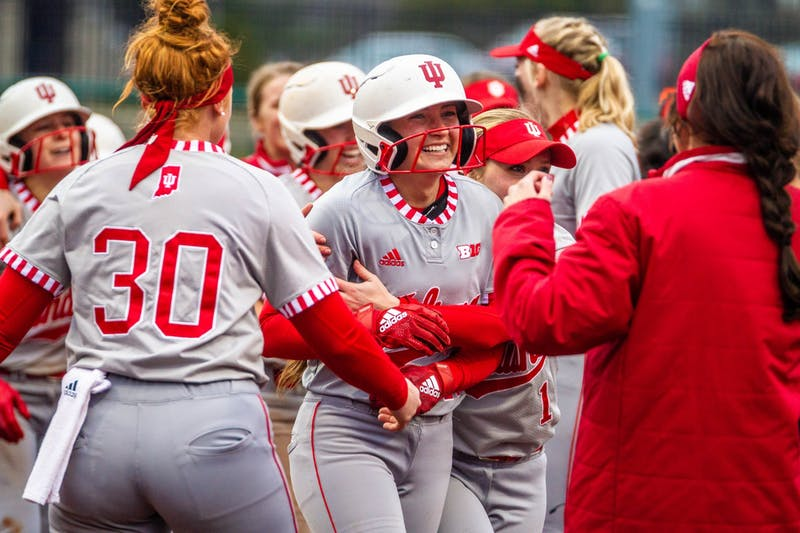 IU cheers after senior Gabbi Jenkins scores and ends the game in the bottom of the seventh inning. IU defeated Miami University 1-0 in its home opener March 10 at Andy Mohr Field.