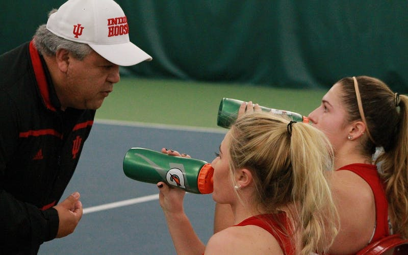 Head coach Ramiro Azcui talks with then-sophomores Madison Appel and Natalie Whalen during a doubles match in 2017. The IU women's tennis team has finished with a top-25 ranked recruiting class for the first time since 2011, according to Tennis Recruiting Network.