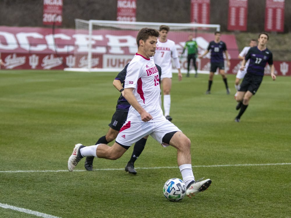 Then-sophomore defender Brett Bebej passes the ball March 23, 2021 in Bill Armstrong Stadium. Bebej scored a goal in the 85th minute of Indiana's 3-0 win against Ohio State on Tuesday night.