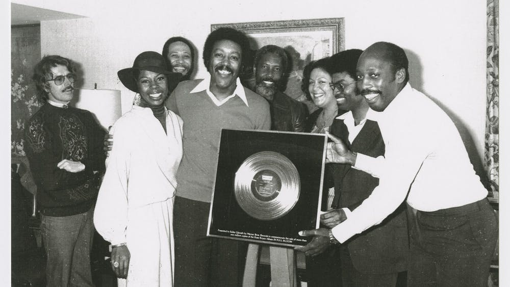 "Eddie Gilreath (middle) is presented with a Gold Record award from Tom Draper (right) for Rose Royce's album ""In Full Bloom"" in 1978. The IU Archives of African American Music and Culture will premiere its documentary series, titled ""AAMC Speaks,"" on Feb. 12 on YouTube."