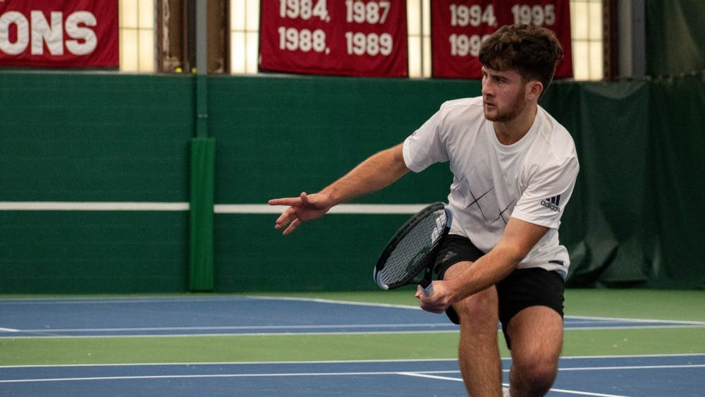 Junior Zac Brodney reaches for a volley Jan. 13 at the IU Tennis Center. He won at No. 5 singles 6-1, 3-6, 7-5 against Ball State University sophomore Chris Adams.