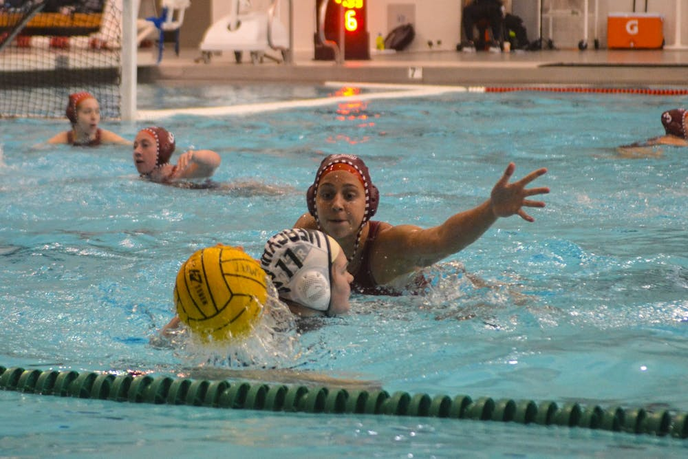 <p>Freshman Taryn Zweifel tries to block Mercyhurst University sophomore Alexa Anderberg from passing the ball March 7 in the Counsilman-Billingsley Aquatics Center. IU defeated Mercyhurst 15-5.</p>